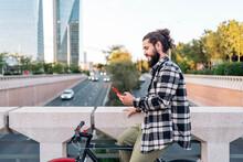 Biker Using His Phone