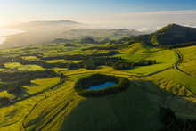 Aerial View Of Lagoa Das Eguas, A Small Lake On Hilltop At Sunset On Sao Miguel Island, Azores Island, Portugal.