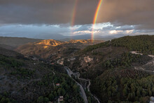Aerial View Of A Colourful Rainbow After A Storm Over The Mountains, Malaga, Andalusia, Spain.