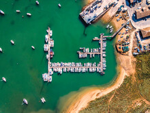 Aerial View Of Boats Anchored At Pier At Alvor City Port In Ribeira De Odiaxere, Alvor, Algarve Region, Portugal.