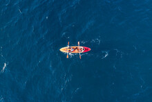 Azores, Portugal - 13 May 2021: Aerial View Of Two Persons Doing Kayak In The Ocean Near San Miguel Island, Azores Islands, Portugal.