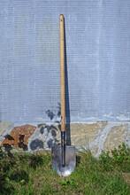 Garden Shovel Near A Concrete Wall Close-up