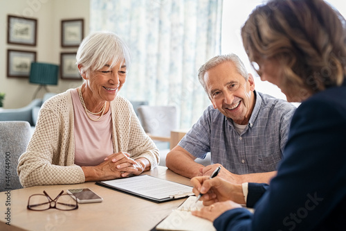 Fotografie, Obraz Senior couple consulting with financial agent
