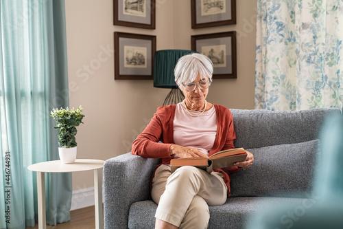 Fototapeta Senior woman reading book at home