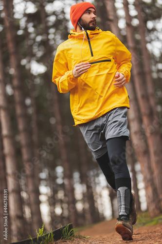 Fototapeta premium Active man jogging in the park
