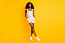 Full Size Photo Of Nice Optimistic Brunette Lady Stand Wear White Dress Sneakers Isolated On Vivid Yellow Color Background