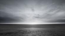 Dark Concrete Floor Background And Dramatic Gray Sky Clouds Horizon