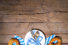 October Fest Concept. Oktoberfest Table Setting Background, Plate Fork Spoon With Traditional Napkin, Served At Event, Bar Menu Flatlay, White Wooden Table Copy Space Top View