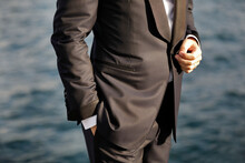 Close-up Of Groom With Hands In Pocket, Waiting For Bride.