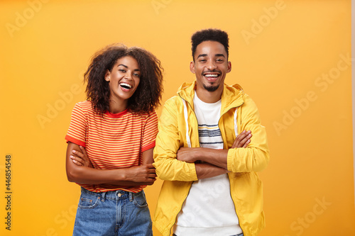Vászonkép Two african american man and woman being best friends laughing out loud watching