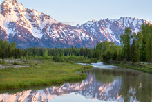Grand Teton Mountains Above Grassy Valley And Snake River In Early Morning Light