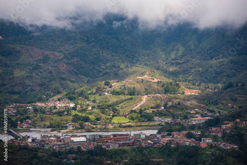 Stampa su Tela Medellin Colombia landscape with clouds on top of hillside of homes