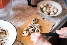 Cooking Of Mushroom Soup. Slicing Champignons With A Knife