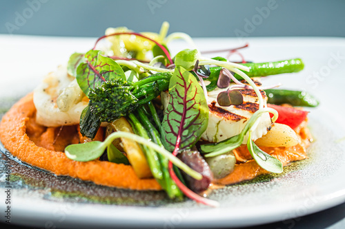 Fototapeta Healthy recipe, organic food and vegetarian salad menu in luxury restaurant, warm vegetables with cheese, greens and herbs served on plate