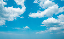 Aerial View Fluffy White Clouds In Blue Sky. Cumulus Cloudscape Nature Background Good Weather In Bright Summer Day. Copy Space Of Natural Color And Light In Heaven. Clear Sunny Weather Forecasting