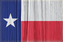 Texas State Flag On Dry Wooden Surface. Bright Background Or Wallpaper Made Of Old Wood With The Symbol Of One Of The American States. Lone Star State. Edge Of The Flag Has Faded Like Light Vignetting
