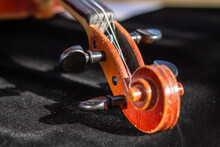 Fragment Of Handmade Violin. Selective Focus. Topic: Bowed Musical Instruments, Background For Poster Of Violin Music Concert, Advertising Background Of Musical Goods