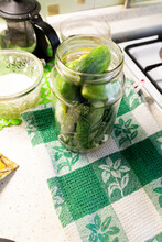 Cooking Preserve In Glass Jar With Fermented Cucumbers With Lemon, Herbs, Spices On White Background
