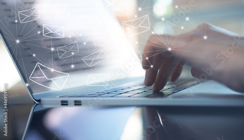 Fotografia Business woman hands using Laptop computer with email icon, Email sent, direct m