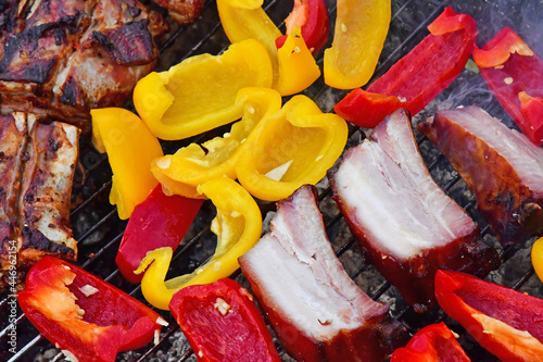 Tela Le Tour du Parc, France - june 6 2021 : pork and sweet pepper on a barbecue