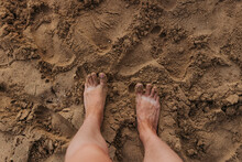 Close Up Of Bare Feet And Sandy Toes On Waikiki Beach At Sunset
