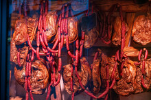 Trento, Italy, June 2021. The Appetizing Window Of A Trentino Specialty Shop: Speck, Hams, Salami Are Displayed In Such A Way As To Attract Customers.