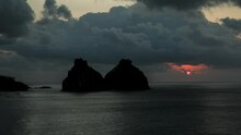 "Sunset Looking At The ""Morro Dois Irmãos"" In Brazilian Marine National Park Fernando De Noronha. State Of Pernambuco, Brazil."