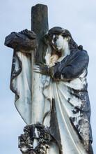 Angle And Cross Statue