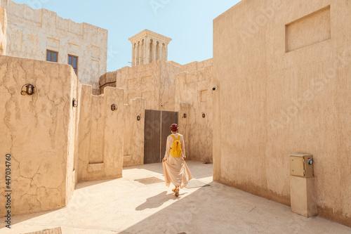 Fotografie, Obraz Woman tourist getting lost the old narrow streets of Bur Dubai and Creek