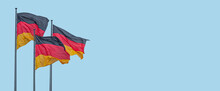 Banner With Three National Black Red Yellow Flags Of Germany In Wind And At Blue Sky Background With Copy Space, Details, Closeup. Concept Of Nationality, Citizenship And Patriotism.