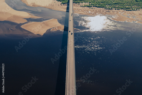 Aerial view of bridge over river with cars Fototapet