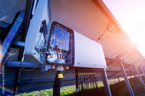Fototapeta Opened voltage inverter at the back side of solar panel