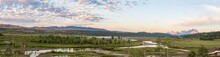Panorama Of Buffalo Fork River Valley In Morning Light With A Mackerel Sky And The Grand Teton Mountains In The Background