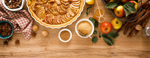 Cooking Thanksgiving Autumn Apple Pie With Fresh Fruits And Walnuts On Wooden Background, Top View. Banner.