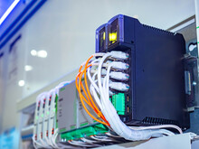 Automation Equipment Concept. Network Equipment At Enterprise. Enterprise Automation. Server Equipment Used For Automation. Mains Wires Go To Electrical Devices. PLC Control Panel.