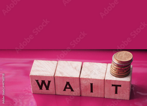 Wallpaper Mural Wait text on a wooden cubes and coins