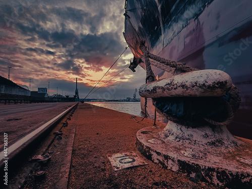 Obraz na plátně cargo vessel at berth, spring line (rope) holding the vessel