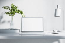 Blank White Laptop Monitor Screen With Copyspce On Light Table With Glass Vase, Teacup And Lamp. 3D Rendering, Mockup