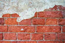 The Background Of A Brick Wall With Remnants Of Plaster, The Empty Texture Of An Old Brick Wall.