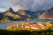 Riano Cityscape At Sunrise With Mountain Range Landscape During Autumn In Picos De Europa National Park, Leon, Spain