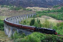 The Jacobite Express Crossing Glenfinnan Viaduct, Mallaig, Highlands, Scotland