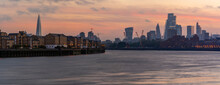 View Of The City Skyline At Sunset From The Thames Path, London, England