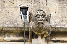 One Of The Many Grotesque Gargoyles Gracing St Peters Parish Church In The Cotswold Town Of Winchcombe, Gloucestershire UK