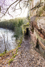 The Entrance To St Constantines Cells - Three Medieval Cave Dwellings Cut Into The Cliff Above The River Eden At Wetheral, Cumbria UK