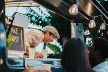 Food Truck Seller Laughing At Joke Of Customers