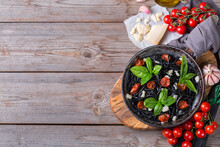 Black Spaghetti Pasta With Tomatoes, Cheese And Basil
