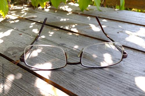 Obraz na plátně glasses on a tabletop made of old unpainted boards