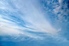Beautiful Blue Clouds Of Unusual Shape At The Horizon Level.