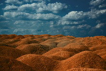 Low Angle Horizon Landscape Of Mound And Dirt Road. Earthwork Ground With Sky Background View