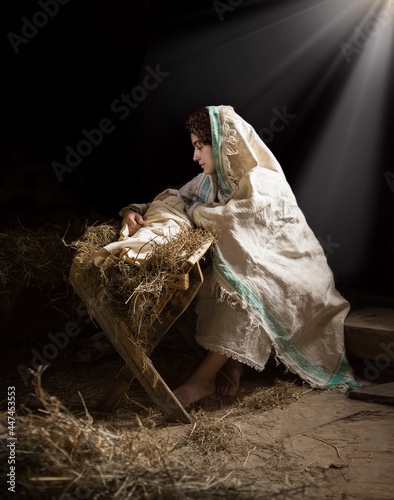 Obraz na plátně Mary sits in the stable near the manger with the baby